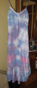 Tie dye gives old clothes a new lease on life. This white dress was stained and ready to be binned
