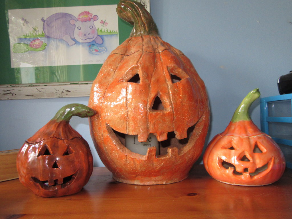 3 Jacks and no Jill. Had so much fun making these Jack o Lanterns at pottery