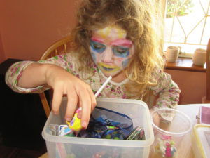 Miss paints her face everyday with the face paints from her big sister.