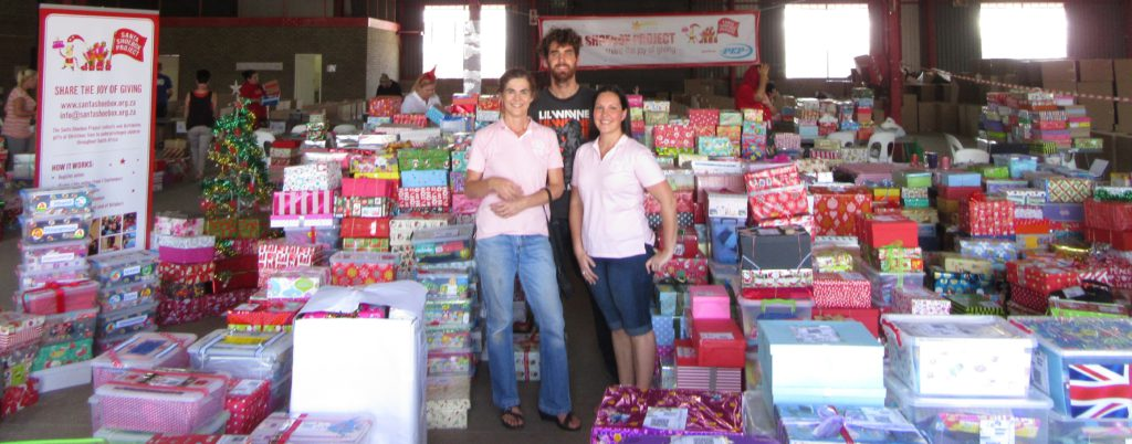 Me, Heath and Reza at the Santa Shoebox warehouse